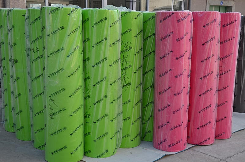 nonwoven fabric in rolls green red color